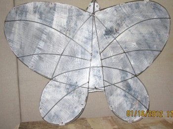 "apollo butterfly grisaille. mobile sculpture. steel 48""w"